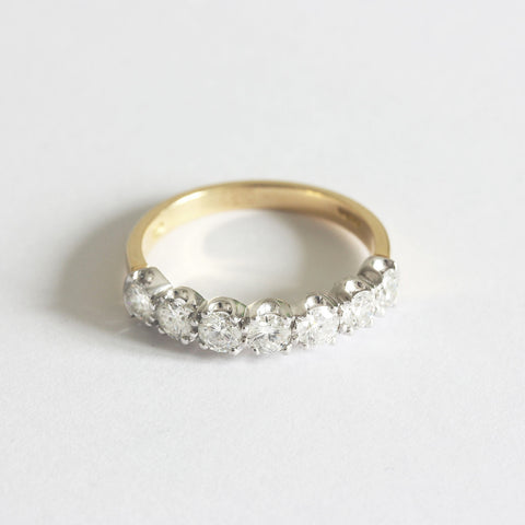 a diamond 7 stone half eternity ring in white and yellow gold
