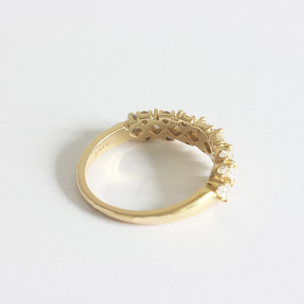 a yellow gold diamond set half hoop ring with claw settings