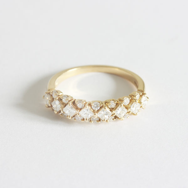 a yellow gold modern diamond set cluster ring