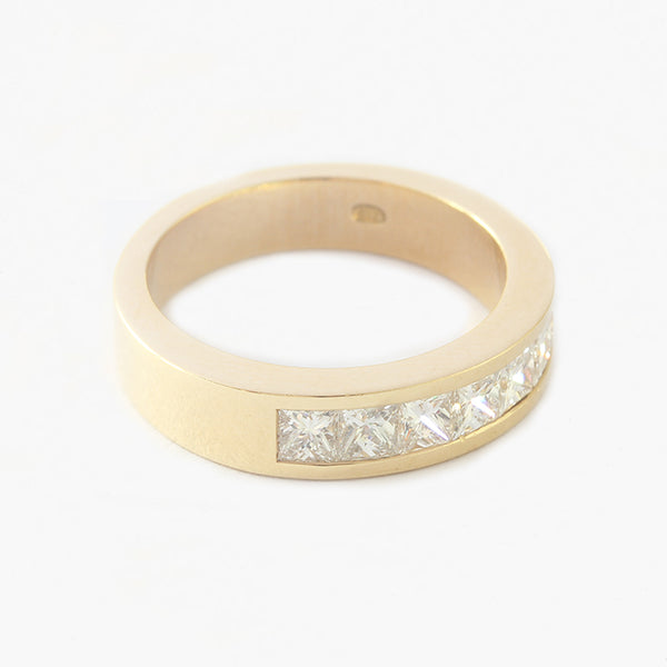 a yellow gold half eternity ring with square stones diamonds
