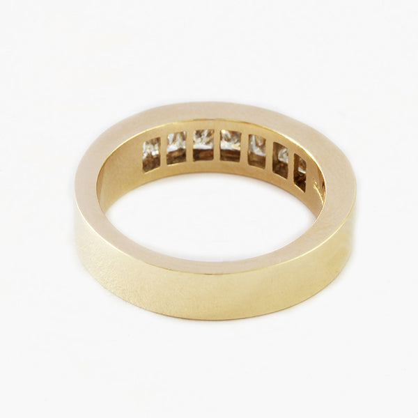 a 7 stone diamond half eternity wedding band in yellow gold