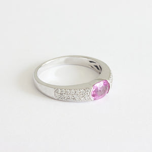a pink sapphire diamond band in white gold