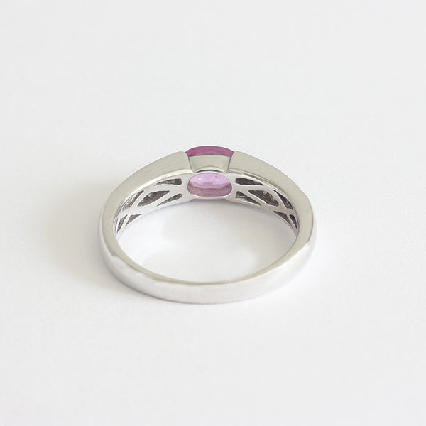 a modern pink sapphire and diamond ring white gold