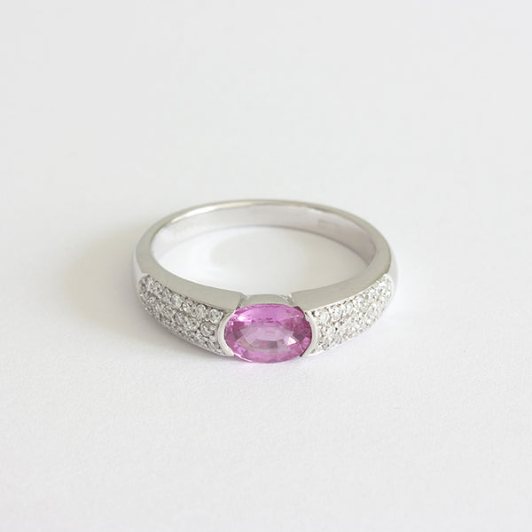 a pretty pink sapphire and diamond ring white gold