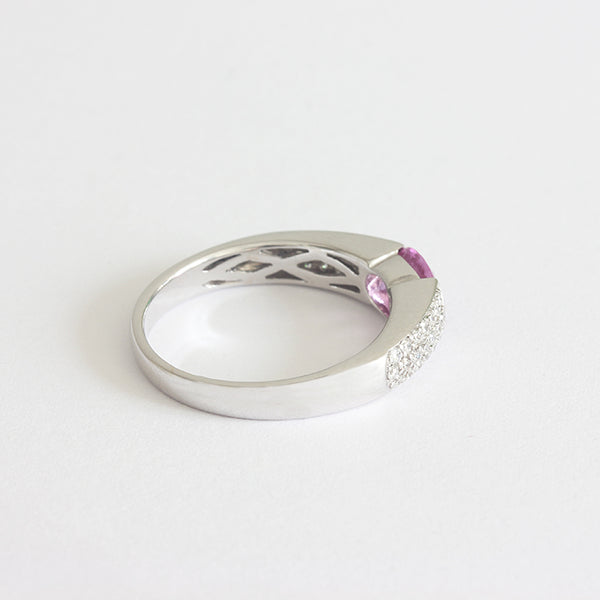 a white gold diamond and pink sapphire ring
