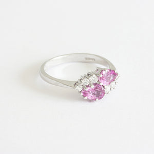 a beautiful pink sapphire and diamond cluster ring claw set white gold