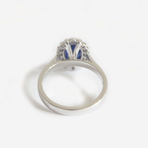 a modern white gold sapphire diamond cluster ring oval