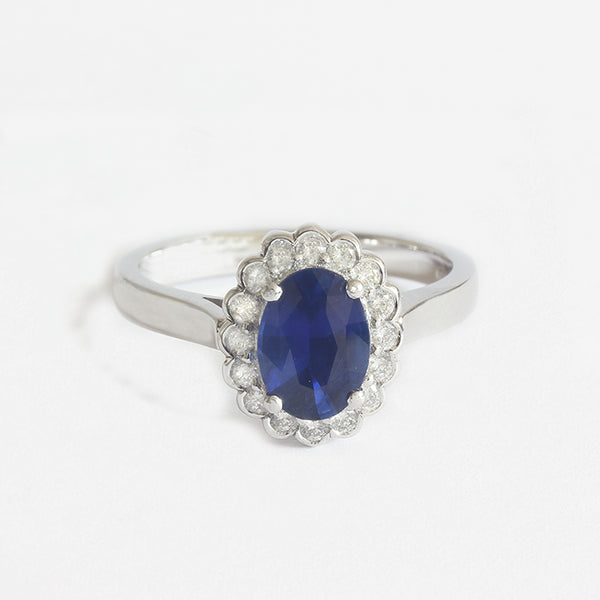 a white gold diamond and sapphire oval cluster ring engagement