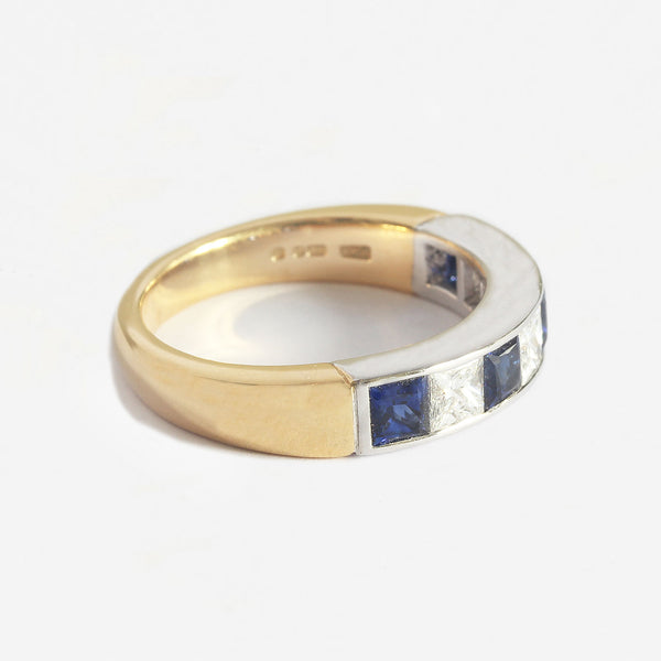 a yellow and white gold half eternity ring with square sapphires and diamonds 7 stones