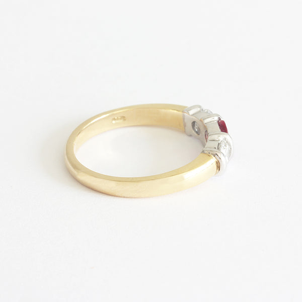 a new gold ring with rubies and diamonds