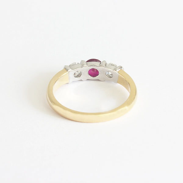 a ruby and diamond 3 stone ring in white and yellow gold with bar settings