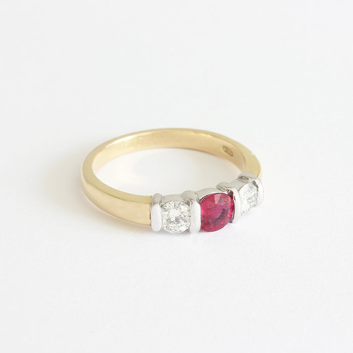 a ruby and diamond 3 stone ring in white and yellow gold