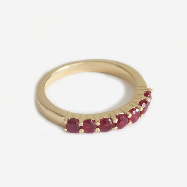 a yellow gold 7 stone claw set round ruby ring