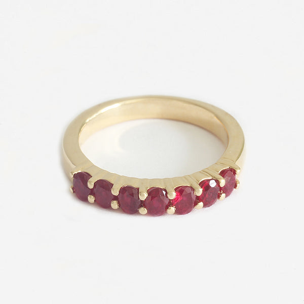a seven stone yellow gold claw set half eternity ring in yellow gold