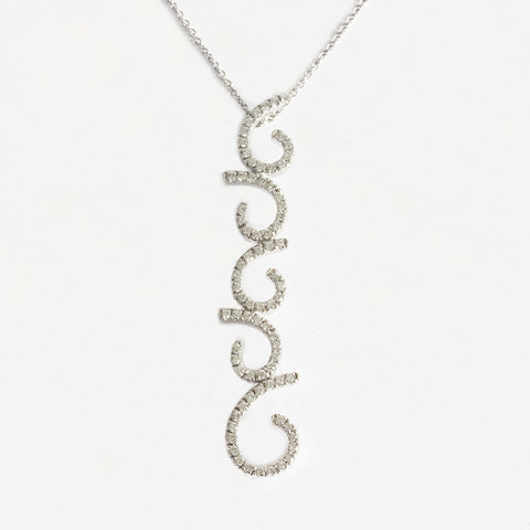 a diamond set curly drop pendant necklace in white gold