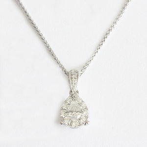 a beautiful pear shaped diamond pendant with cluster diamonds on a white gold chain