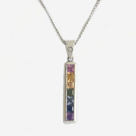 a square long pendant with multi coloured sapphires and diamond loop in white gold