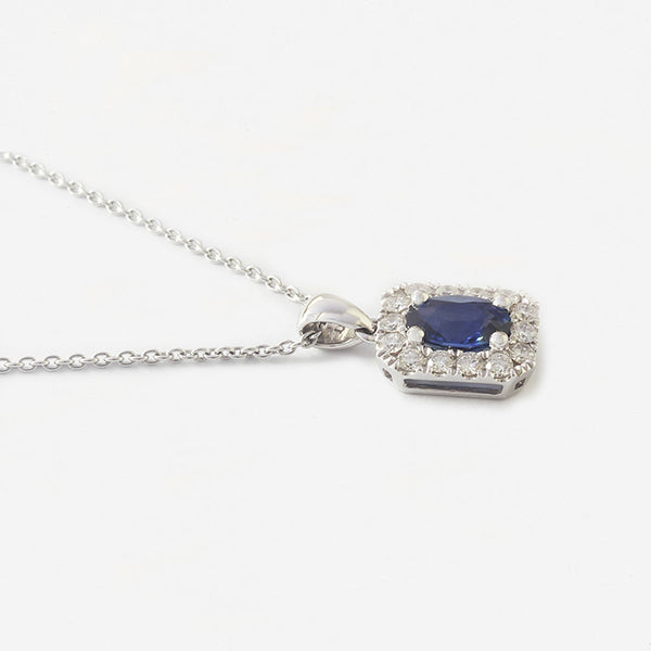a white gold sapphire and diamond rectangle shaped pendant and chain