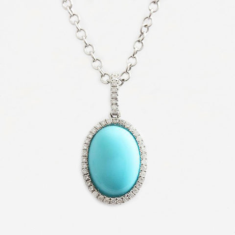 an oval turquoise and diamond cluster pendant necklace white gold