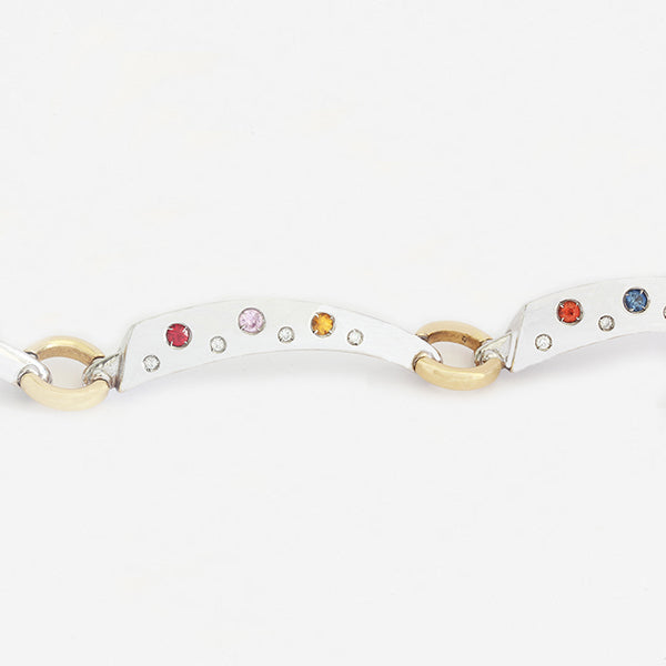 a new white gold multi sapphire and diamond link bracelet