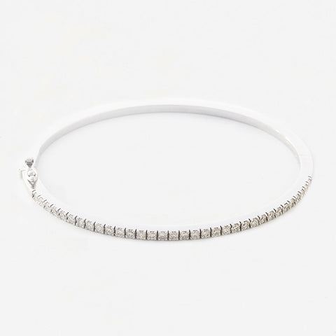 a modern diamond set hinged bangle in white gold with figure of eight catch