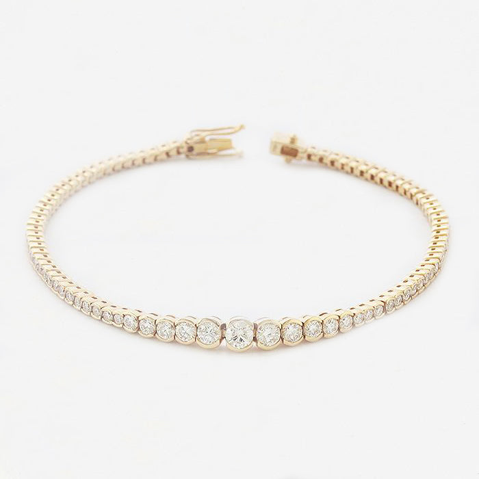 a diamond set graduated yellow gold stunning bracelet