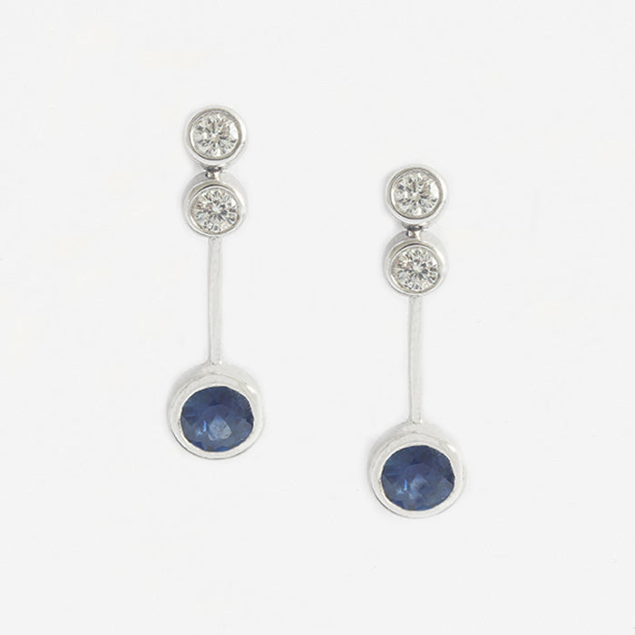 a modern white gold diamond and sapphire 3 stone drop design earrings