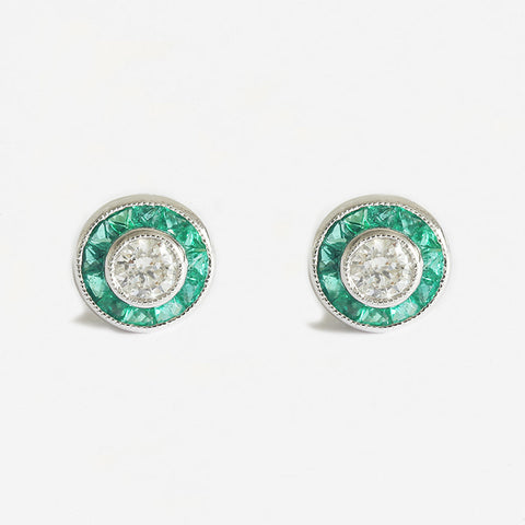 a stunning pair of emerald and diamond round cluster stud earrings in white gold