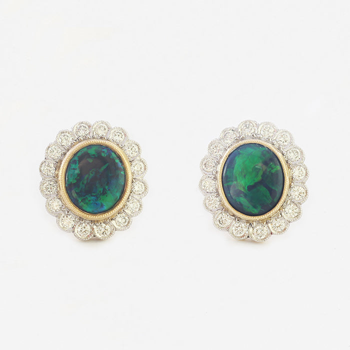 a pair of beautiful black opal and diamond oval cluster studs in 18 carat gold
