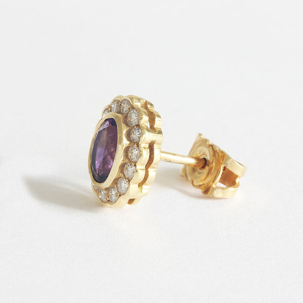 a beautiful pair of amethyst diamond cluster earrings studs