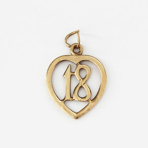 a 9ct yellow gold 18 birthday charm with a heart shaped border