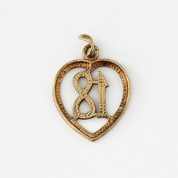 a vintage secondhand yellow gold 18 birthday pendant charm with heart border