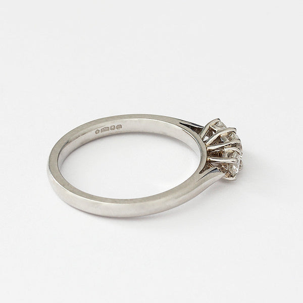 a modern 3 stone diamond ring with a claw setting and set in platinum