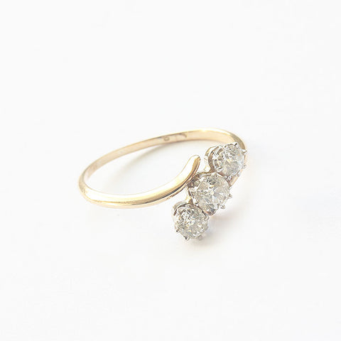 a 3 stone diamond brilliant cut ring in claw set and gold