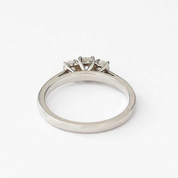 a diamond 3 stone engagement ring with claws and set in platinum