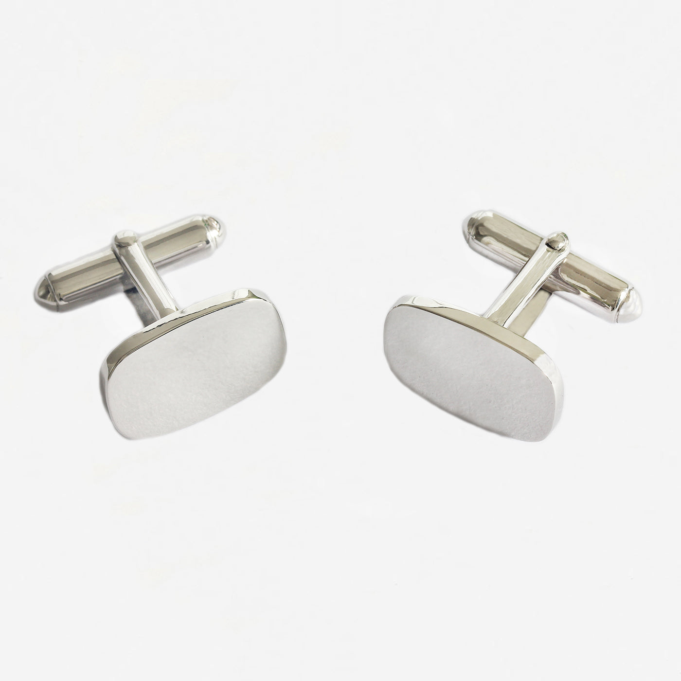 a pair of sterling silver plain cushion shaped cufflinks with bar connectors