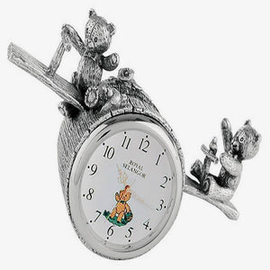 a children's clock with a teddy bear seesaw theme by royal selangor and made in pewter