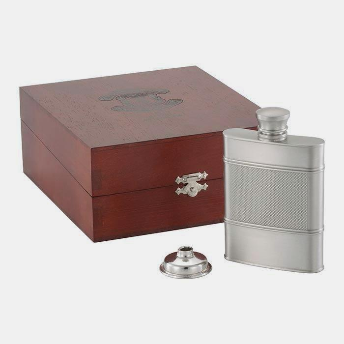 a pewter hip flask with an engine turned pattern and a presentation box by royal selangor