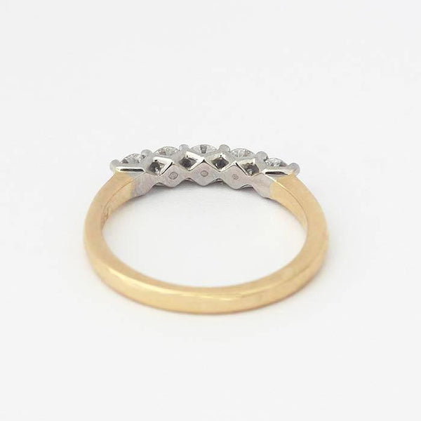 diamond set  stone eternity wedding ring in yellow and white gold