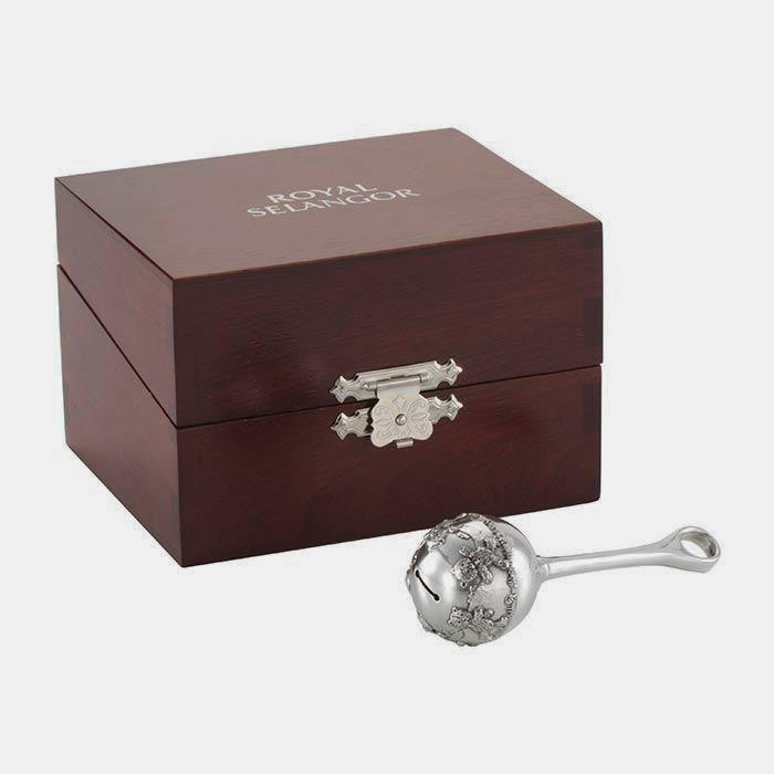 a baby rattle made from pewter with a teddy bear theme and a wooden presentation box by royal selangor