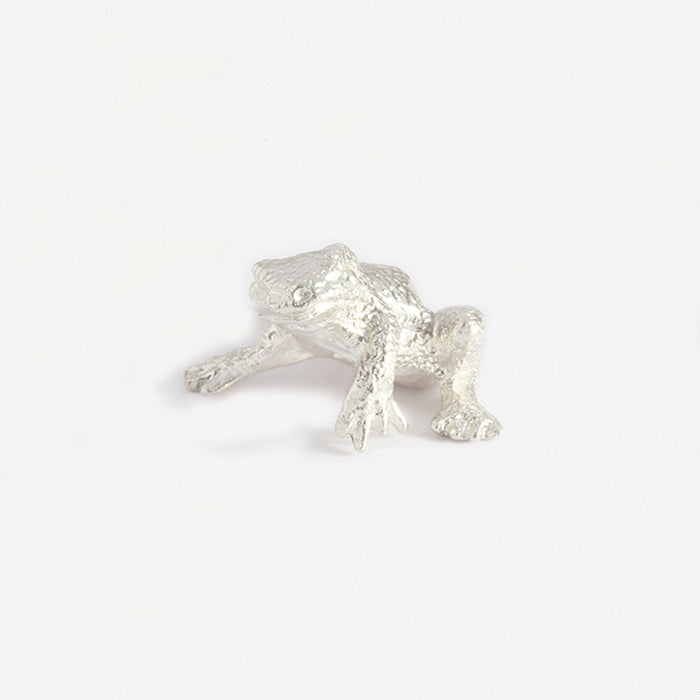 a silver detailed small frog ornament collectible