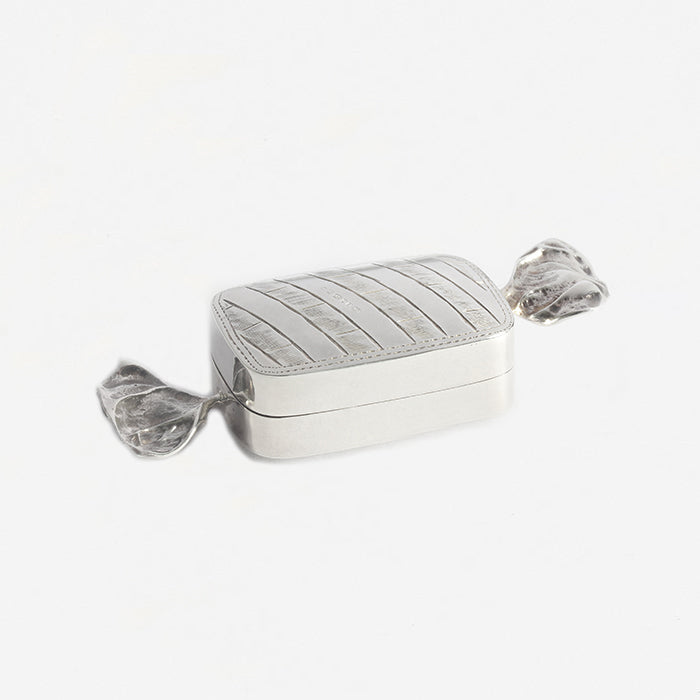 a silver pill box sweet design shape with full hallmark