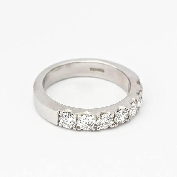 a round brilliant cut 7 stone diamond claw set half eternity ring in platinum