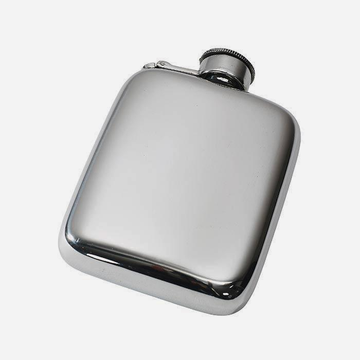 a polished pewter hip flask with rounded edges and a captive top