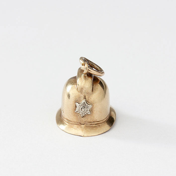 gold fireman helmet charm with great detail