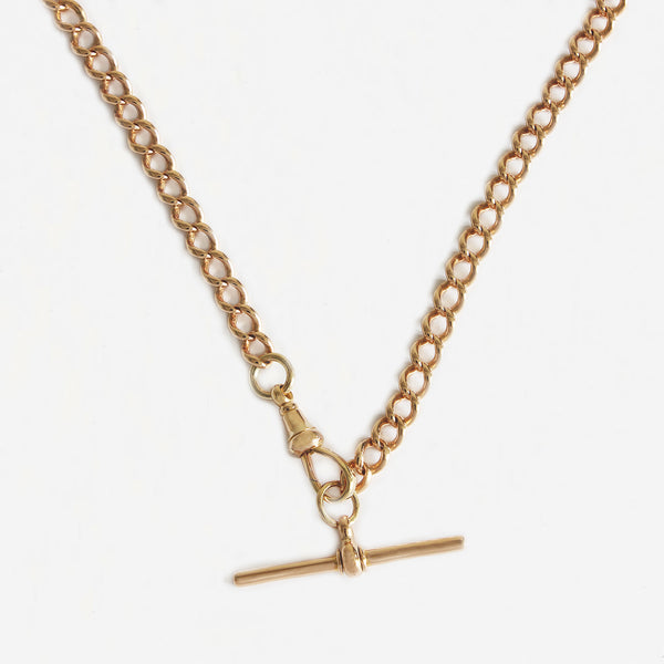 a secondhand 15 carat yellow gold Albert watch chain with t bar attached