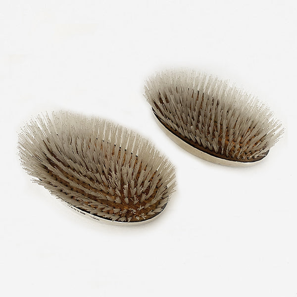 a pair of silver gents hairbrushes dated 1935