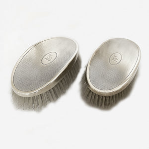 a silver pair of hairbrushes dated birmingham 1935