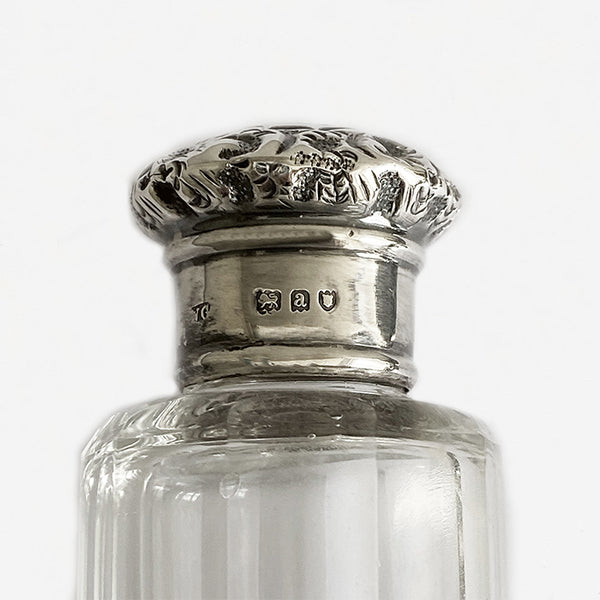 a glass and silver victorian hatpin bottle dated 1896