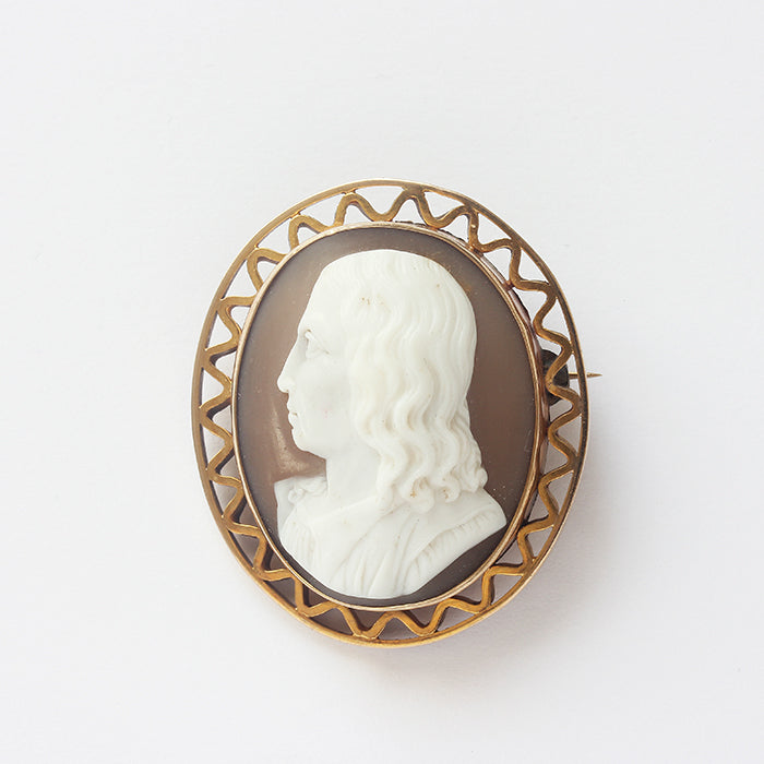a cameo secondhand brooch with a man profile in yellow gold border